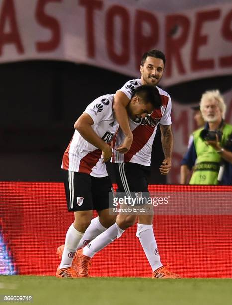 Ignacio Scocco of River Plate celebrates with teammate Gonzalo Martinez after scoring the first goal of his team during a first leg match between...