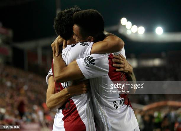 Ignacio Scocco of River Plate celebrates with teammate Gonzalo Martinez after scoring the first goal of his team during a second leg match between...