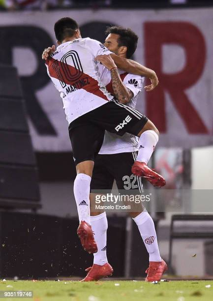 Ignacio Scocco of River Plate celebrates with teammate Gonzalo Martinez after scoring the third goal of his team during a match between River Plate...