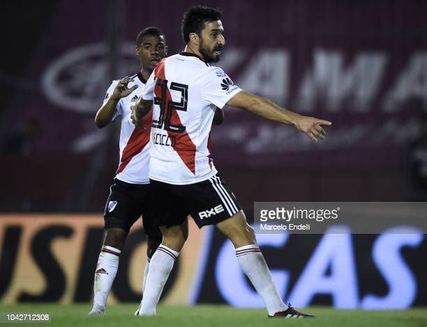 Ignacio Scocco of River Plate celebrates with teammates after scoring the first goal of his team during a match between Lanus and River Plate as part...