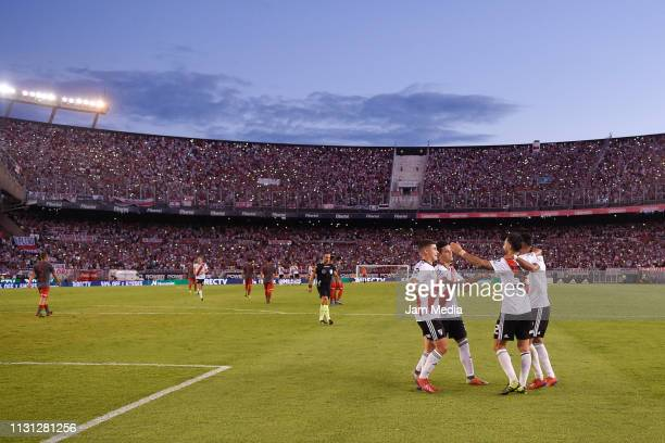 Ignacio Scocco of River Plate celebrates with teammates after scoring the second goal of his team during a match between River Plate and...