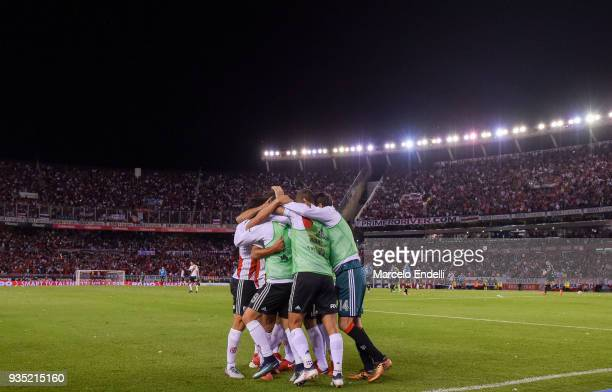 Ignacio Scocco of River Plate celebrates with teammates after scoring the second goal of his team during a match between River Plate and Belgrano as...