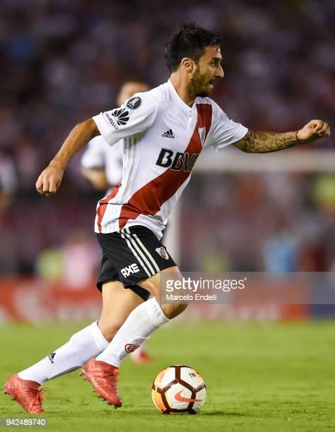 Ignacio Scocco of River Plate drives the ball during a Copa CONMEBOL Libertadores match between River Plate and Independiente Santa Fe at Estadio...