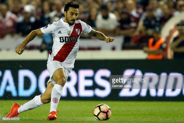 Ignacio Scocco of River Plate drives the ball during a second leg match between Lanus and River Plate as part of the semifinals of Copa CONMEBOL...