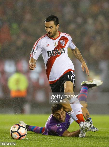 Ignacio Scocco of River Plate drives the ball to score the first goal of his team during a second leg match between River Plate and Wilstermann as...