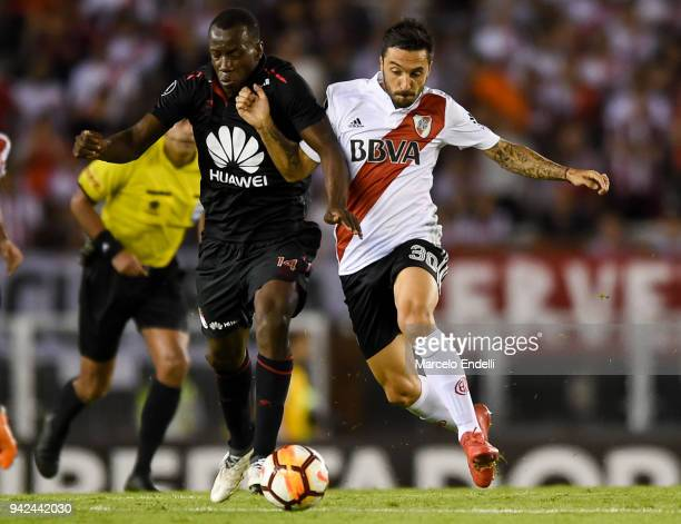 Ignacio Scocco of River Plate fights for ball with Baldomero Perlaza of Independiente Santa Fe during a Copa CONMEBOL Libertadores match between...