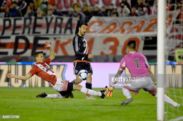 Ignacio Scocco of River Plate fights for the ball Facundo Aguero of Instituto during a match between River Plate and Instituto as part of round 16 of...