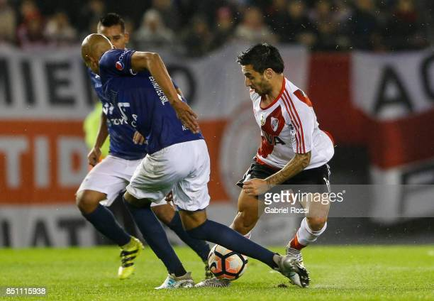 Ignacio Scocco of River Plate fights for the ball with Alex Silva of Wilstermann during a second leg match between River Plate and Wilstermann as...