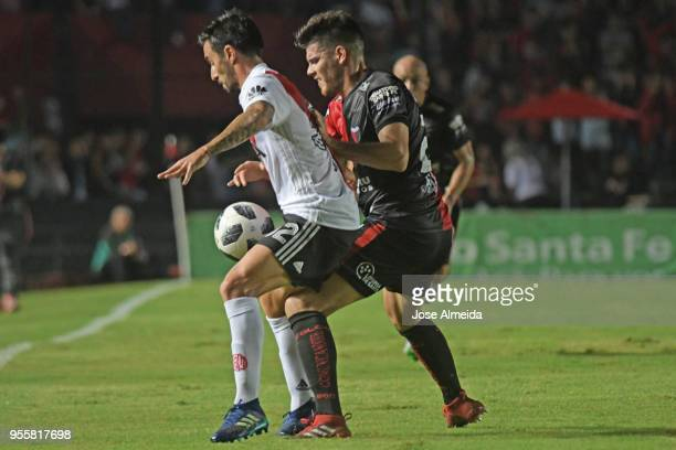 Ignacio Scocco of River Plate fights for the ball with Guillermo Ortiz of Colon during a match between Colon and River Plate as part of Superliga at...