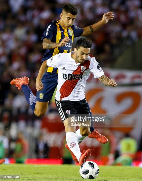 Ignacio Scocco of River Plate fights for the ball with Joaquin Pereyra of Rosario Central during a match between River Plate and Rosario Central as...