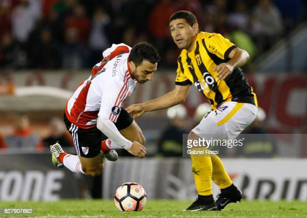 Ignacio Scocco of River Plate fights for the ball with Luis Alberto Cabral of Guarani during a second leg match between River Plate and Guarani as...