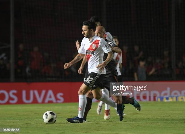 Ignacio Scocco of River Plate fights for the ball with Matias Fritzler of Colon during a match between Colon and River Plate as part of Superliga at...