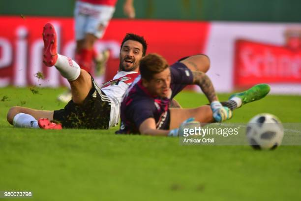 Ignacio Scocco of River Plate fights for the ball with Maximiliano Velazco goalkeeper of Arsenal during a match between Arsenal and River Plate as...