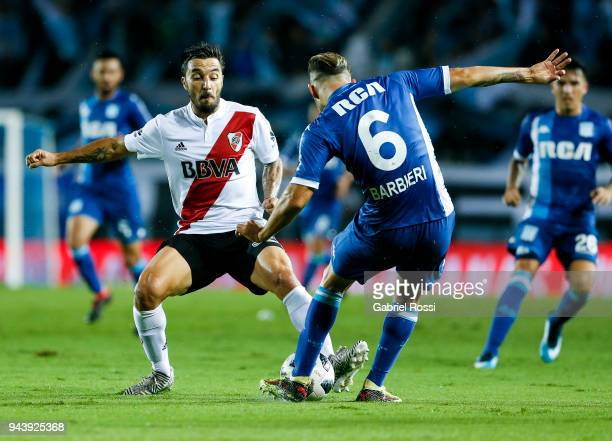 Ignacio Scocco of River Plate fights for the ball with Miguel Barbieri of Racing Club during a match between Racing Club and River Plate as part of...