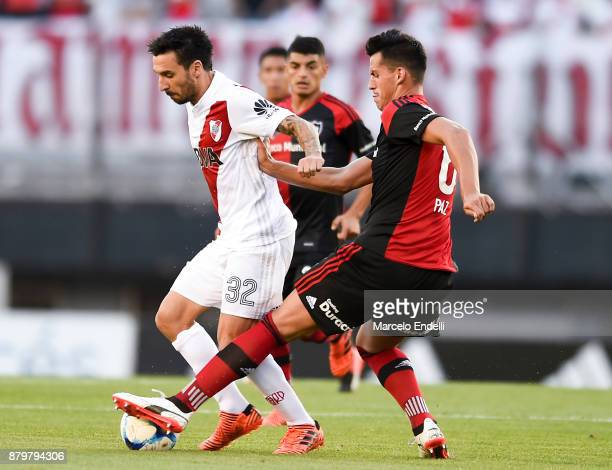 Ignacio Scocco of River Plate fights for the ball with Nehuen Paz of Newell's Old Boys during a match between River and Newell's Old Boys as part of...