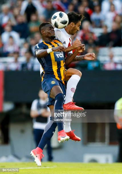 Ignacio Scocco of River Plate fights for the ball with Oscar Cabezas of Rosario Central during a match between River Plate and Rosario Central as...