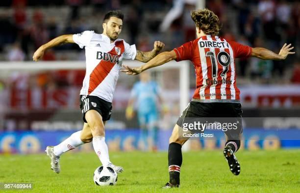 Ignacio Scocco of River Plate fights for the ball with Sebastian Dubarbier of Estudiantes during a match between River Plate and Estudiantes de La...