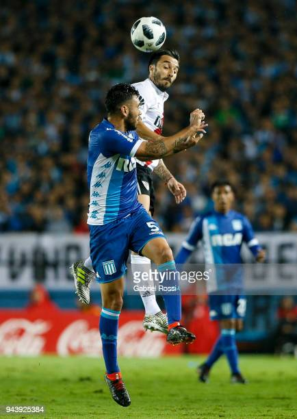 Ignacio Scocco of River Plate goes for a header with Nery Dominguez of Racing Club during a match between Racing Club and River Plate as part of...
