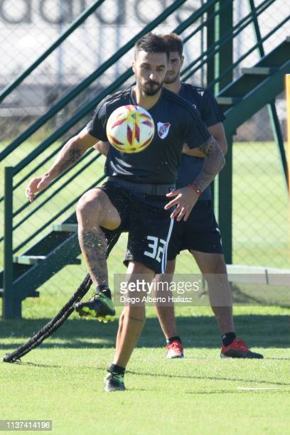 Ignacio Scocco of River Plate kicks the ball during a training session at River Camp Ezeiza on March 21 2019 in Buenos Aires Argentina