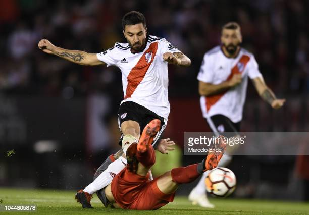 Ignacio Scocco of River Plate kicks the ball to score the first goal of his team during a quarter final second leg match of Copa CONMEBOL...