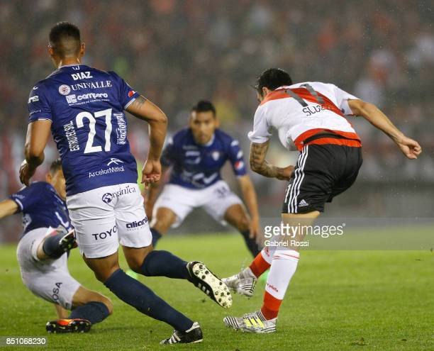 Ignacio Scocco of River Plate kicks the ball to score the second goal of his team during a second leg match between River Plate and Wilstermann as...