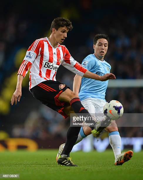 Ignacio Scocco of Sunderland controls the ball under pressure from Samir Nasri of Manchester City during the Barclays Premier League match between...