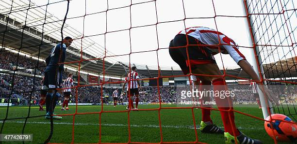 Ignacio Scocco of Sunderland picks the ball out of the net after Curtis Davies of Hull City's goal during the FA Cup Quarter Final match between Hull...