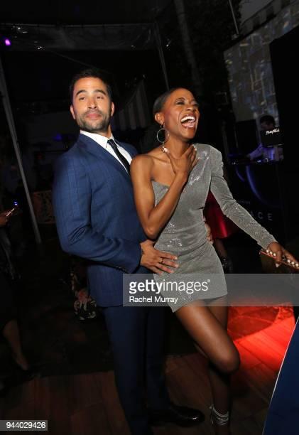 Ignacio Serricchio and Sibongile Mlambo attend Netflix's 'Lost In Space' Los Angeles premiere on April 9 2018 in Los Angeles California