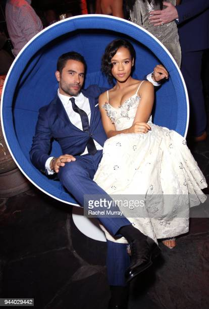 Ignacio Serricchio and Taylor Russell attend Netflix's 'Lost In Space' Los Angeles premiere on April 9 2018 in Los Angeles California