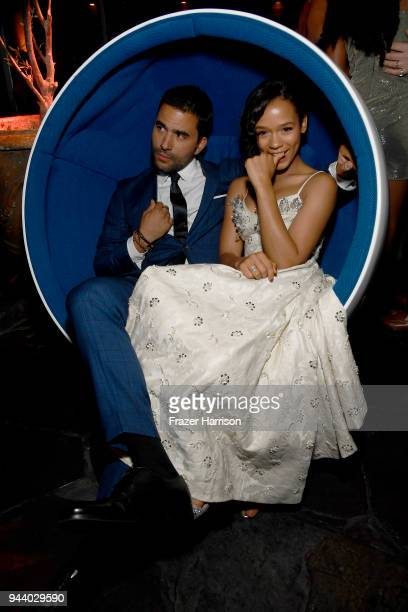 Ignacio Serricchio and Taylor Russell attend the Premiere Of Netflix's 'Lost In Space' Season 1 After Party at Le Jardin LA on April 9 2018 in Los...