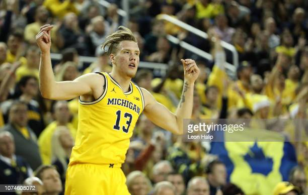 Ignas Brazdeikis of the Michigan Wolverines celebrates a three point shot during the second half of the game against the Air Force Falcons at Crisler...