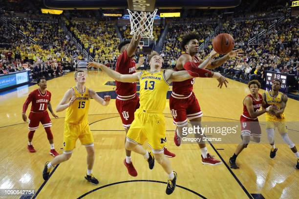 Ignas Brazdeikis of the Michigan Wolverines gets fouled on the way to the basket by Justin Smith of the Indiana Hoosiers at Crisler Arena on January...