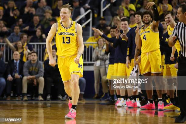 Ignas Brazdeikis of the Michigan Wolverines reacts after second half three point basket while playing the Nebraska Cornhuskers at Crisler Arena on...