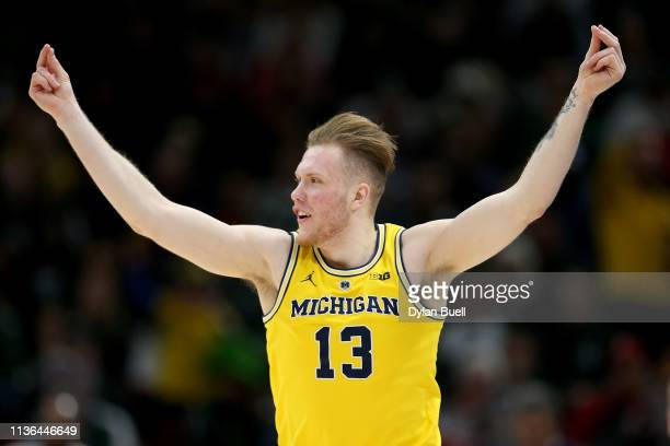 Ignas Brazdeikis of the Michigan Wolverines reacts in the first half against the Michigan State Spartans during the championship game of the Big Ten...