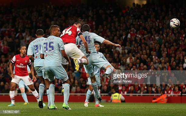 Ignasi Miquel of Arsenal scores their fifth goal from a header during the Capital One Cup third round match between Arsenal and Coventry City at...