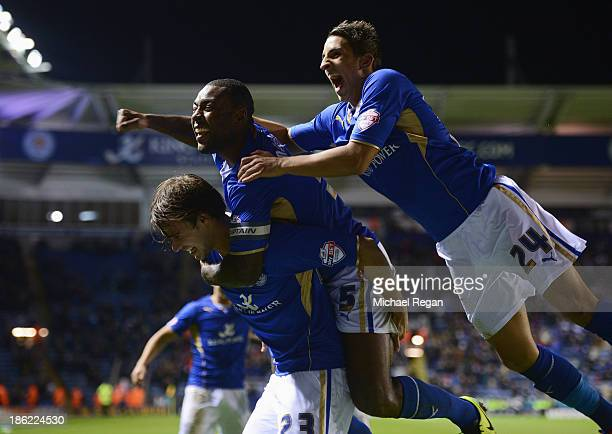 Ignasi Miquel of Leicester City celebrates scoring his team's third goal with Wes Morgan and Anthony Knockaert during the Capital One Cup fourth...