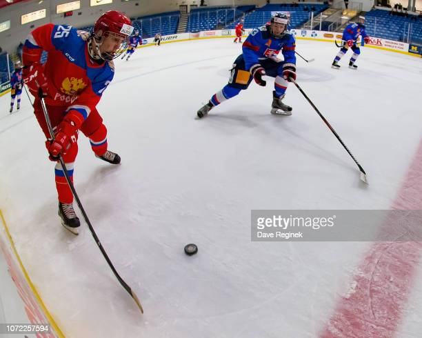 Ignat Kokhanin of the U17 Russian Nationals skates up ice with the puck next to Oleksiy Myklukha of the U17 Slovakia Nationals during day2 of game...