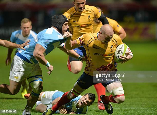 Ignatio Brex of Argentina Jaguars vies for the ball with Danut Dumbrava of Romania during 'World Rugby Nations Cup' in Bucharest on June 21 2015...