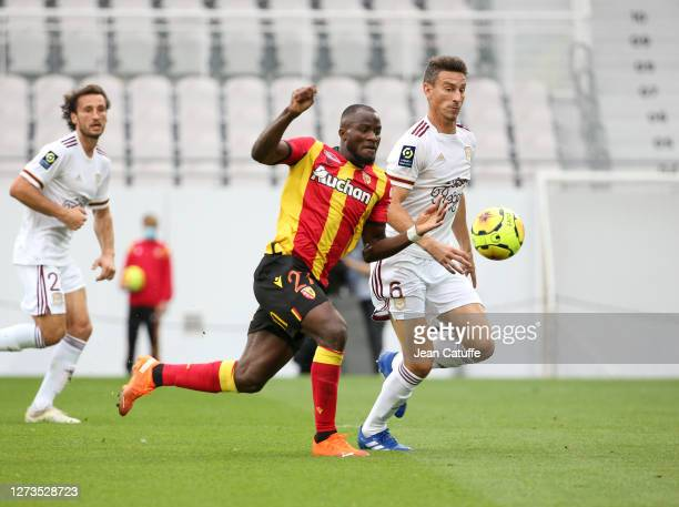 Ignatius Ganago of Lens, Laurent Koscielny of Bordeaux in action during the Ligue 1 match between RC Lens and Girondins de Bordeaux at Stade...
