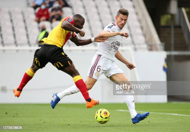 Ignatius Ganago of Lens vies for control against Laurent Koscielny of Bordeaux during the Ligue 1 match between RC Lens and Girondins de Bordeaux at...