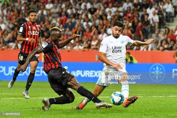 Ignatius Ganago of Nice and Morgan Sanson of OM during the Ligue 1 match between OGC Nice and Olympique de Marseille on August 28, 2019 in Nice,...