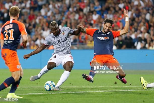 Ignatius Ganago of OGC Nice shoots the ball against Pedro Felipe Teodosio Mendes of Montpellier Herault SC during the Ligue 1 match between...