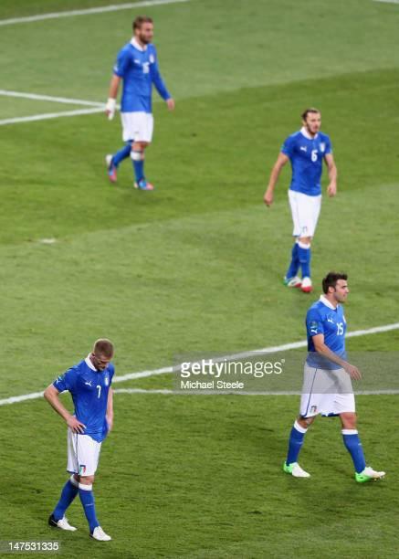 Ignazio Abate and Andrea Barzagli of Italy show their dejection after the UEFA EURO 2012 final match between Spain and Italy at the Olympic Stadium...