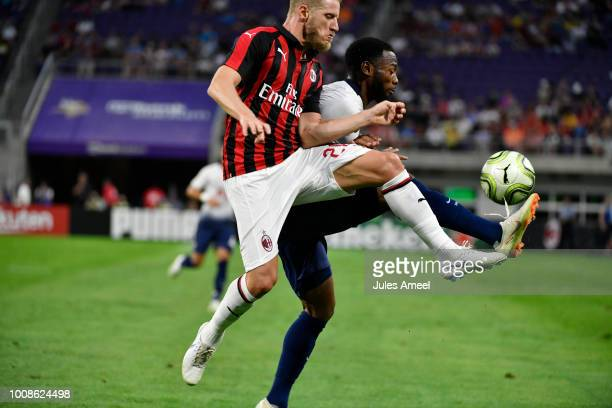 Ignazio Abate of AC Milan and Georges-Kévin N'Koudou of the Tottenham Hotspur vie for the ball during the first half of the International Champions...