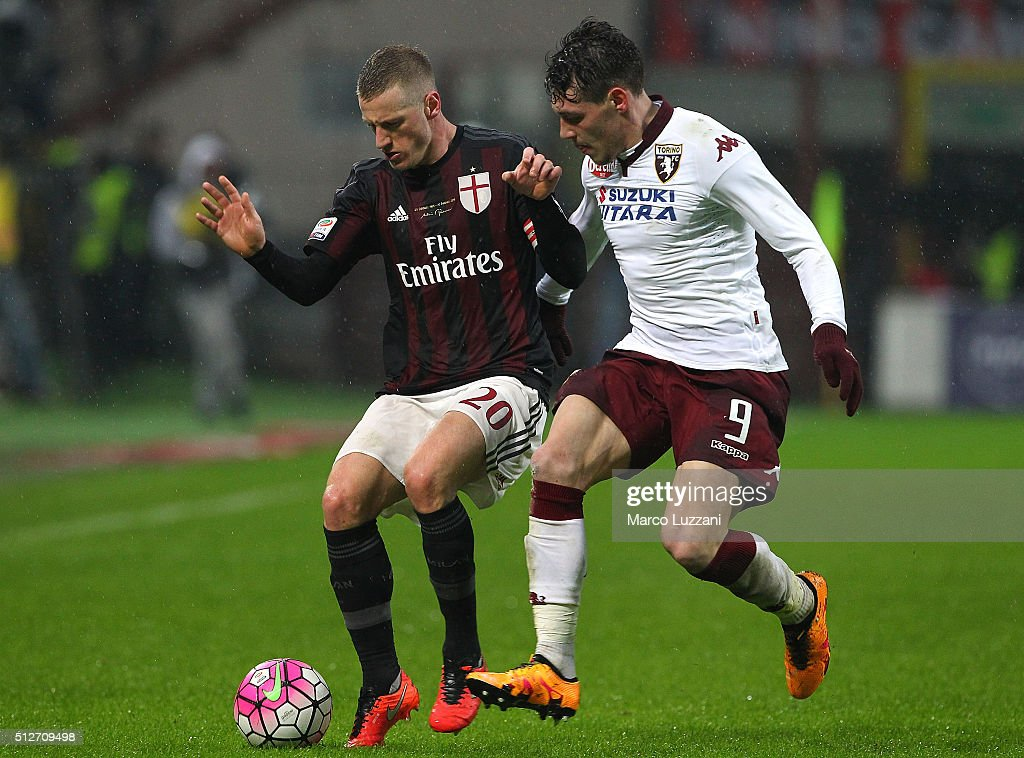 Ignazio Abate of AC Milan competes for the ball with Andrea Belotti of Torino FC during the Serie A match between AC Milan and Torino FC at Stadio Giuseppe Meazza on February 27, 2016 in Milan, Italy.