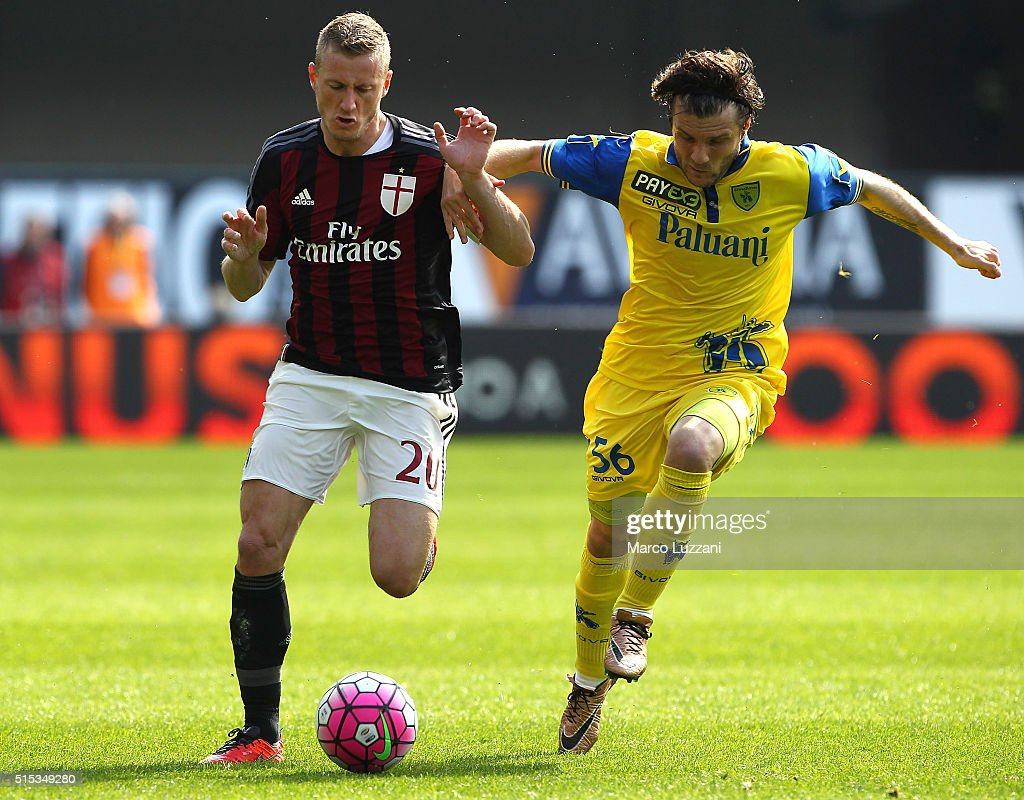 Ignazio Abate of AC Milan competes for the ball with Perparim Hetemaj of AC Chievo Verona during the Serie A match between AC Chievo Verona and AC Milan at Stadio Marc'Antonio Bentegodi on March 13, 2016 in Verona, Italy.