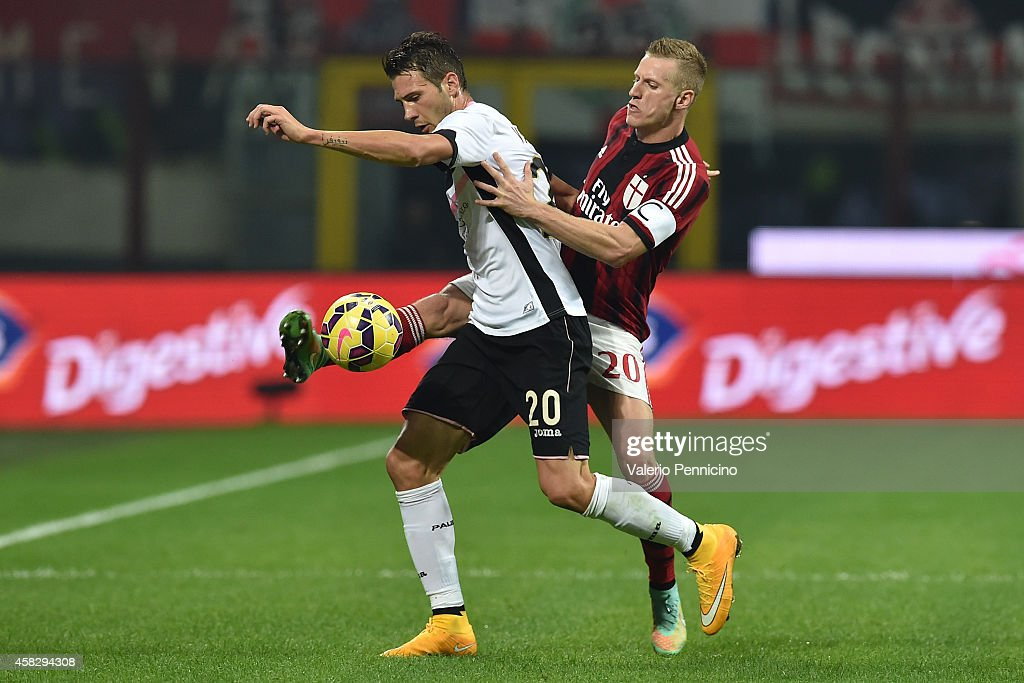 Ignazio Abate (R) of AC Milan competes with Franco Vazquez of US Citta di Palermo during the Serie A match between AC Milan and US Citta di Palermo at Stadio Giuseppe Meazza on November 2, 2014 in Milan, Italy.