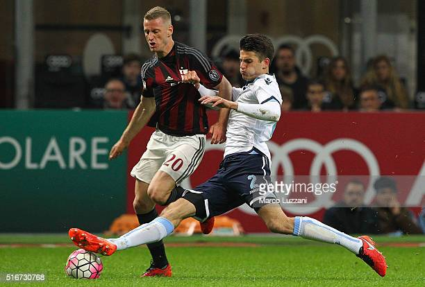 Ignazio Abate of AC Milan is challenged by Stefan de Vrij of SS Lazio during the Serie A match between AC Milan and SS Lazio at Stadio Giuseppe...