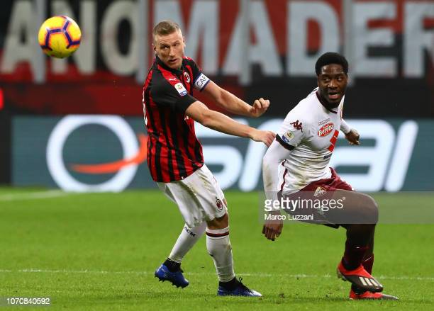 Ignazio Abate of AC Milan s challenged by Ola Aina of Torino FC during the Serie A match between AC Milan and Torino FC at Stadio Giuseppe Meazza on...