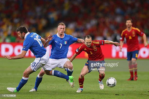 Ignazio Abate of Italy pulls the shirt of Andres Iniesta of Spain during the UEFA EURO 2012 final match between Spain and Italy at the Olympic...